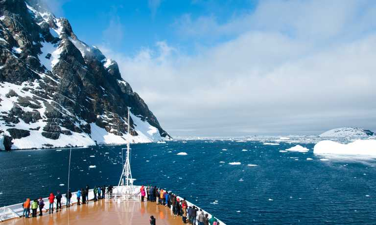 Fly to Antarctica & Cruise back